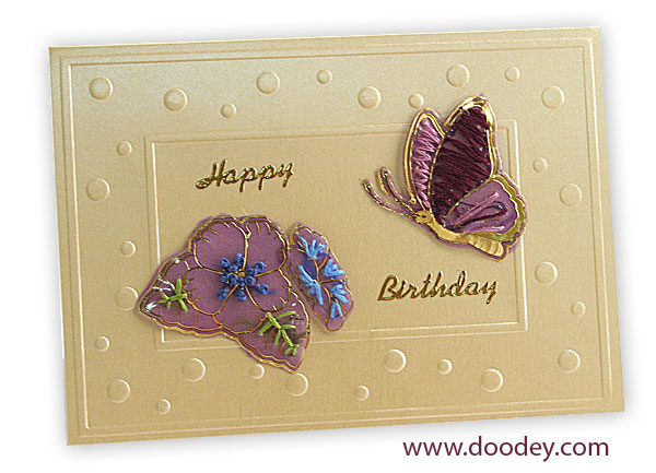 Embroidery butterfly with flower on a card with ro